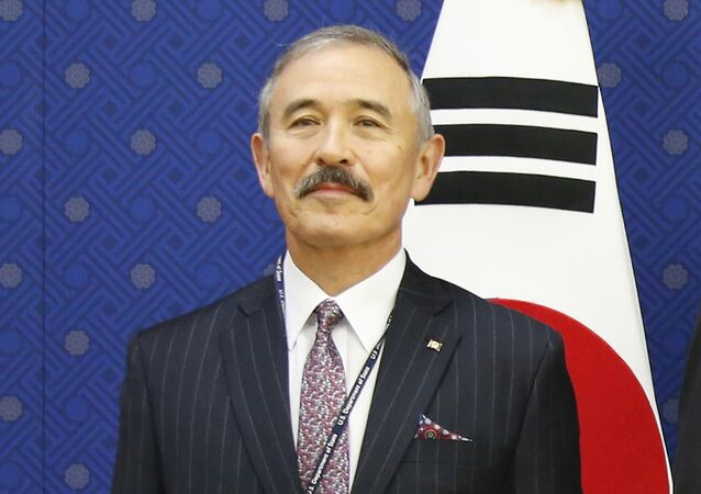 U.S. Ambassador to Seoul Harry Harris pose for photos during their meeting at the Foreign Ministry in Seoul, South Korea