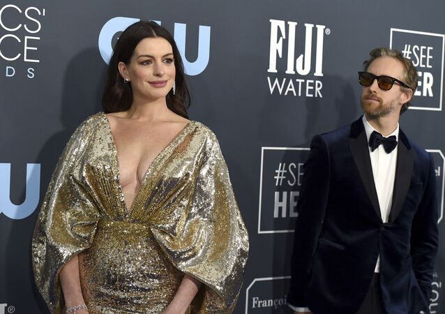 Anne Hathaway, left, and Adam Shulman arrive at the 25th annual Critics' Choice Awards on Sunday, Jan. 12, 2020, at the Barker Hangar in Santa Monica, Calif.