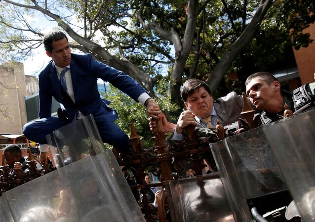 Venezuelan opposition leader Juan Guaido, who many nations have recognised as the country's rightful interim ruler, and other lawmakers climb on the fence of Venezuela's National Assembly building in Caracas, Venezuela January 5, 2020