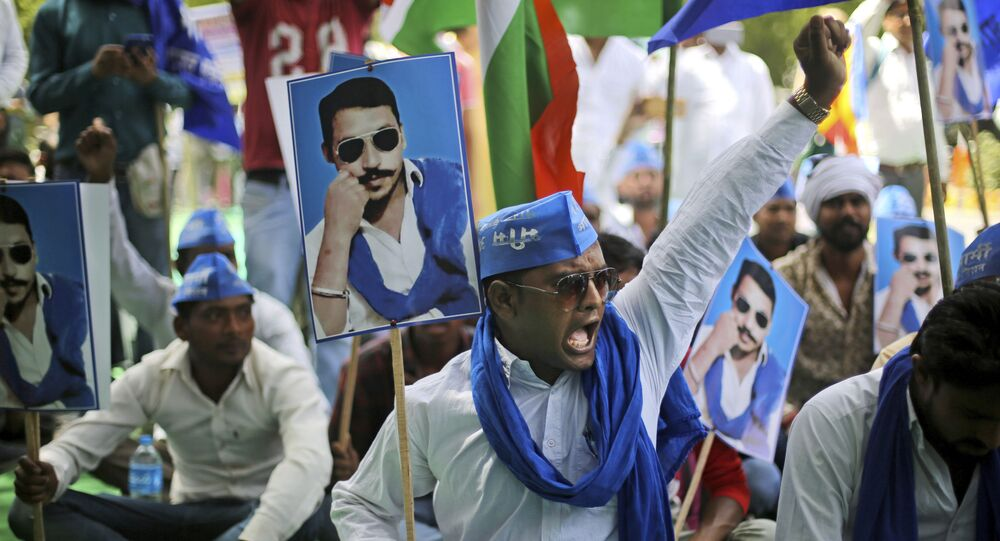 A Dalit protester shouts slogans during a protest demanding the release of their leader and Bhim Army founder Chandrashekhar Azad in New Delhi, India, Wednesday, April 18, 2018