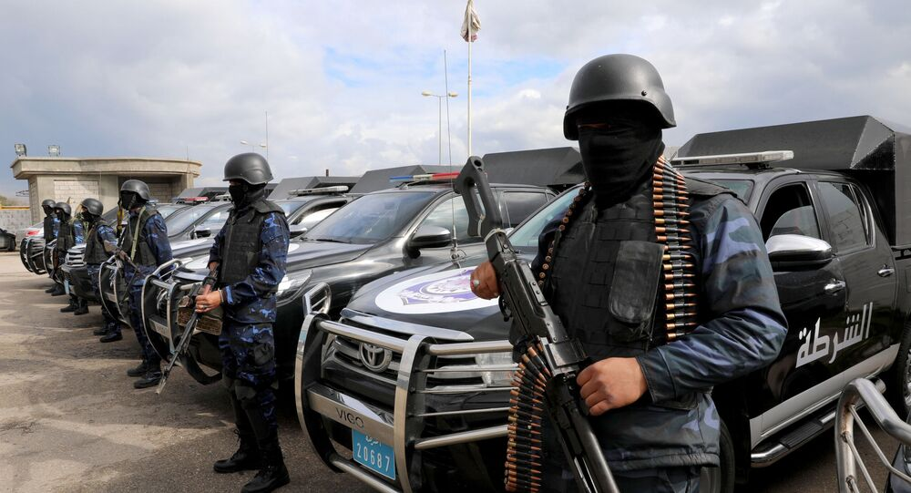 Central security support force carry weapons during the security deployment in the Tajura neighborhood, east of Tripoli, Libya January 14, 2020