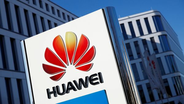 The logo of Huawei Technologies is pictured in front of the German headquarters of the Chinese telecommunications giant in Duesseldorf, Germany, February 18, 2019.   - Sputnik International