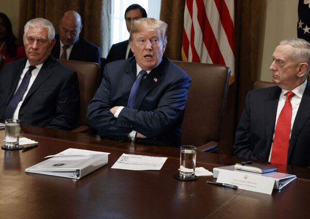 Secretary of State Rex Tillerson, left, and Secretary of Defense Jim Mattis, right, listen as President Donald Trump