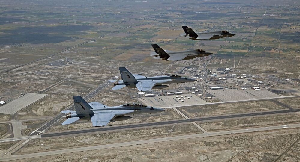 F-35C Lightning IIs, attached to the Grim Reapers of Strike Fighter Squadron (VFA) 101, and an F/A-18E/F Super Hornets attached to the Naval Aviation Warfighter Development Center (NAWDC) fly over Naval Air Station Fallon (NASF).