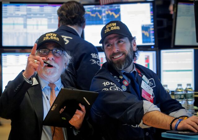 Traders work on the floor at the New York Stock Exchange (NYSE) in New York, U.S., January 15, 2020.