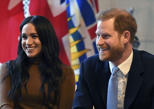 Britain's Prince Harry and Meghan