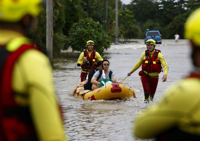 This image from a video, shows a submerged car on Gold Coast, Australia Saturday, Jan. 18, 2020. Heavy rain lashed parts of Australia's New South Wales and Queensland states on Saturday causing flashfloods, while wildfires continue to burn in other parts of the country.