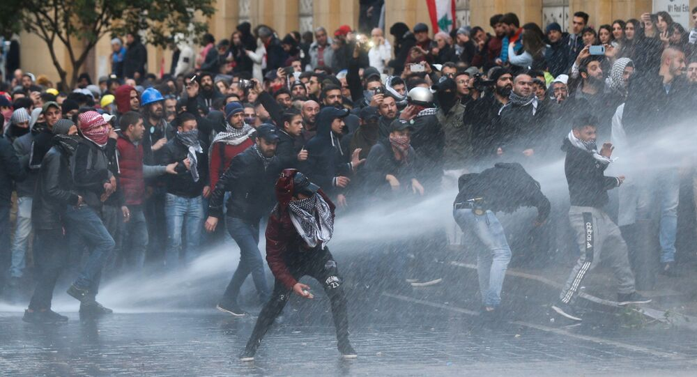 Demonstrators Hit by Water Canon During Protests in Beirut