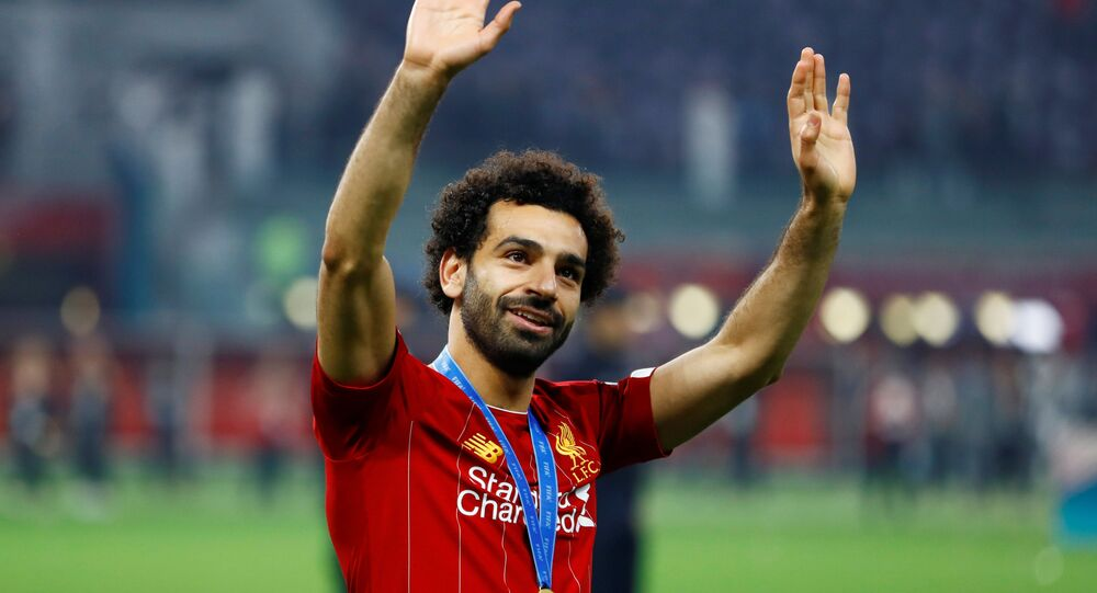 Soccer Football - Club World Cup - Final - Liverpool v Flamengo - Khalifa International Stadium, Doha, Qatar - December 21, 2019  Liverpool's Mohamed Salah celebrates winning the Club World Cup