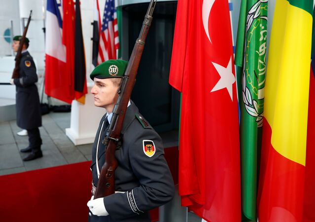 German soldiers stand guard at the Chancellery before the Libya summit in Berlin, Germany, January 19, 2020.  REUTERS/Hannibal Hanschke