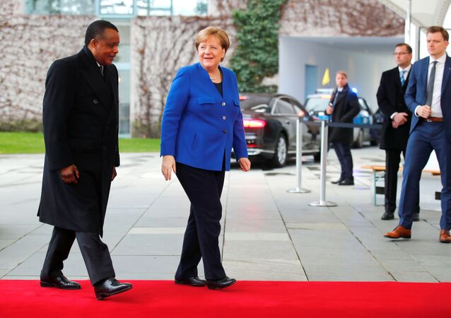 German Chancellor Angela Merkel welcomes Republic of the Congo's President Denis Sassou Nguesso at the beginning of the Libya summit in Berlin, Germany, January 19, 2020.  REUTERS/Hannibal Hanschke