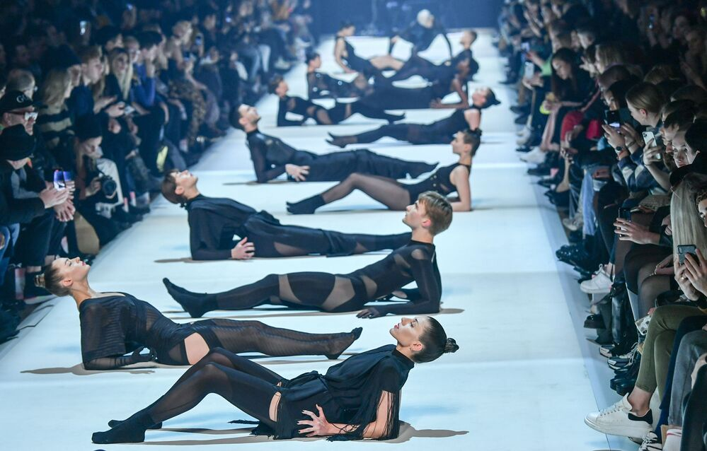 Dancers present creations from the label Dont Shoot The Messengers (DSTM) during a fashion show at Berlin Fashion Week on 15 January 2020 in Berlin.