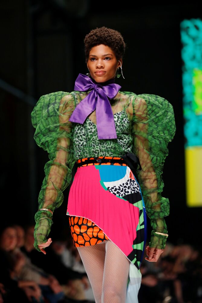 A model presents a creation in a show of talents from South Africa, during the Berlin Fashion Week in Berlin, Germany, on 13 January 2020.