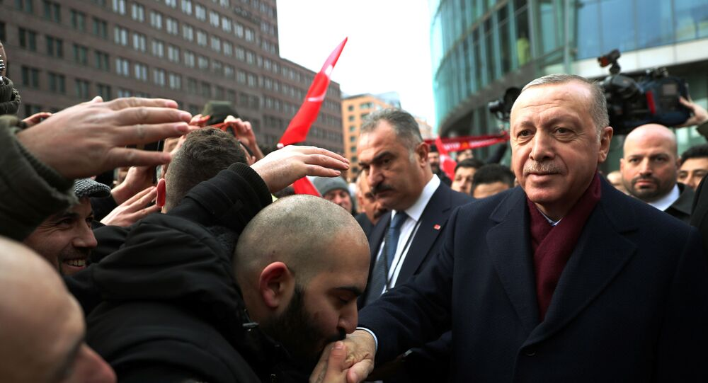 Turkish President Tayyip Erdogan is greeted by his supporters as he arrives for the Libya summit in Berlin, Germany, January 19, 2020.
