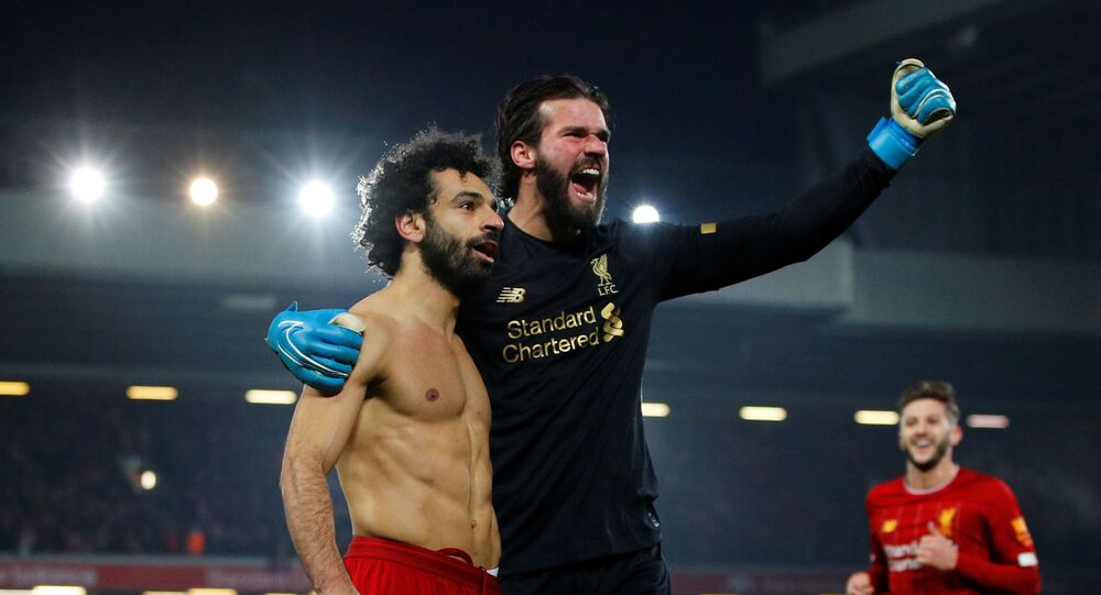 Soccer Football - Premier League - Liverpool v Manchester United - Anfield, Liverpool, Britain - January 19, 2020   Liverpool's Mohamed Salah celebrates scoring their second goal with Alisson