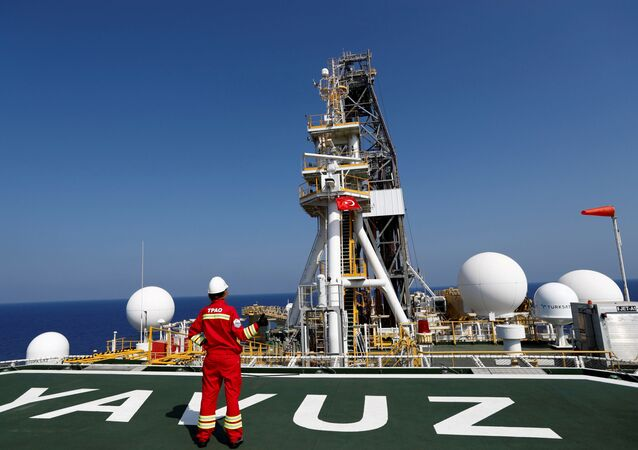 A Turkish Petroleum (TPAO) engineer poses on the helipad of Turkish drilling vessel Yavuz in the eastern Mediterranean Sea off Cyprus, August 6, 2019