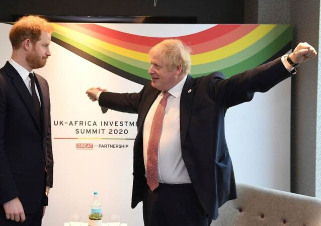 Britain's Prince Harry and Prime Minister Boris Johnson, left, at the UK Africa Investment Summit in London, Monday 20 January 2020. Boris Johnson is hosting 54 African heads of state or government in London.