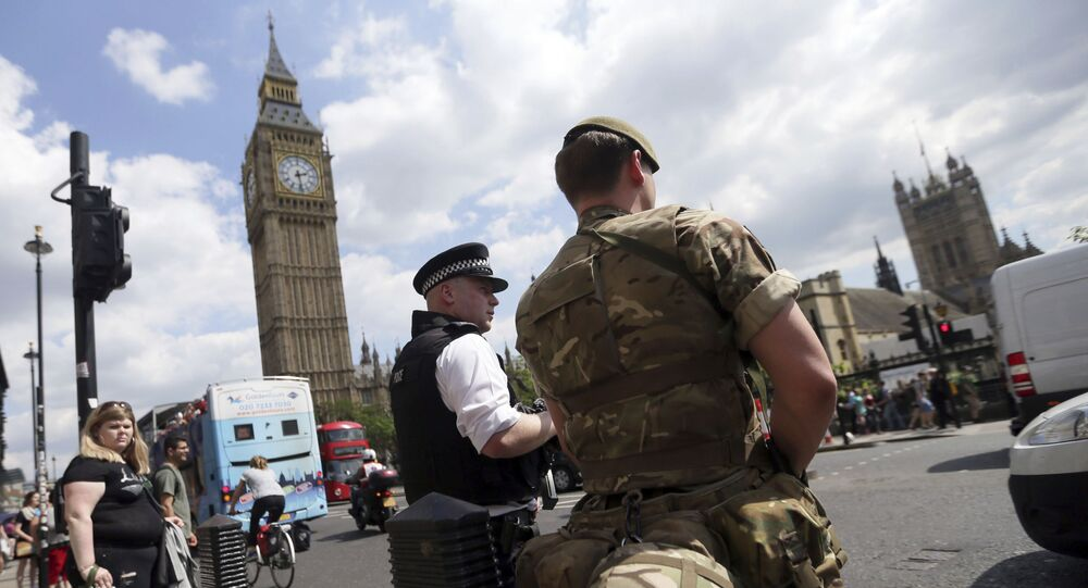 A member of the army joins police officers in Westminster, London, Wednesday, 24 May 2017