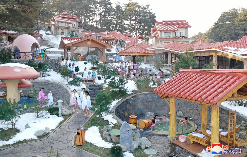 People are seen at the outdoor baths in Yangdok Hot Spring Resort, North Korea, in this undated photo released on January 14, 2020 by North Korea's Korean Central News Agency (KCNA).