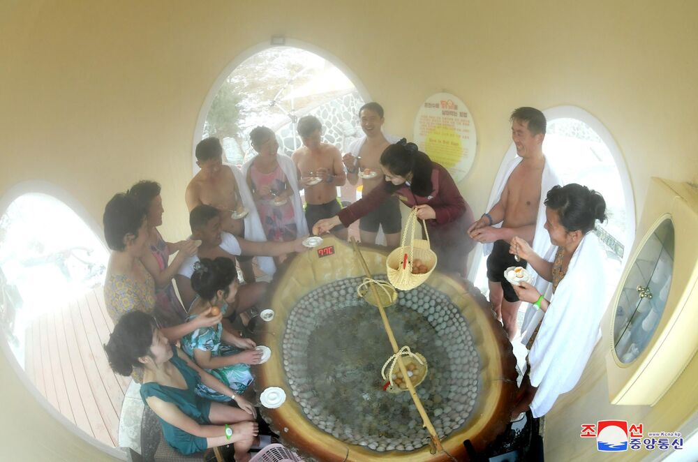 People boil eggs at the Yangdok Hot Spring Resort, North Korea, in this undated photo released on January 14, 2020 by North Korea's Korean Central News Agency (KCNA).