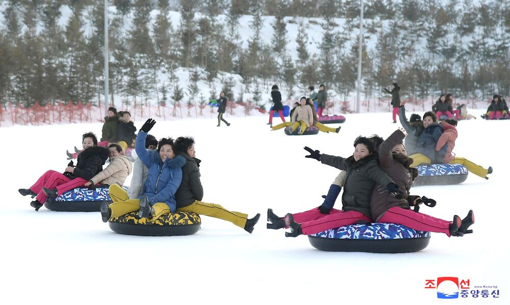People play in the snow at the Yangdok Hot Spring Resort, North Korea, in this undated photo released on January 14, 2020 by North Korea's Korean Central News Agency (KCNA).