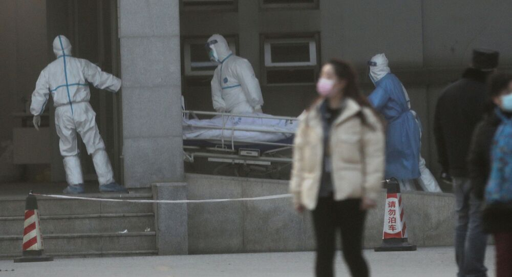 Medical staff transfer a patient at the Jinyintan hospital, where the patients with pneumonia caused by the new strain of coronavirus are being treated, in Wuhan, Hubei province, China January 20, 2020
