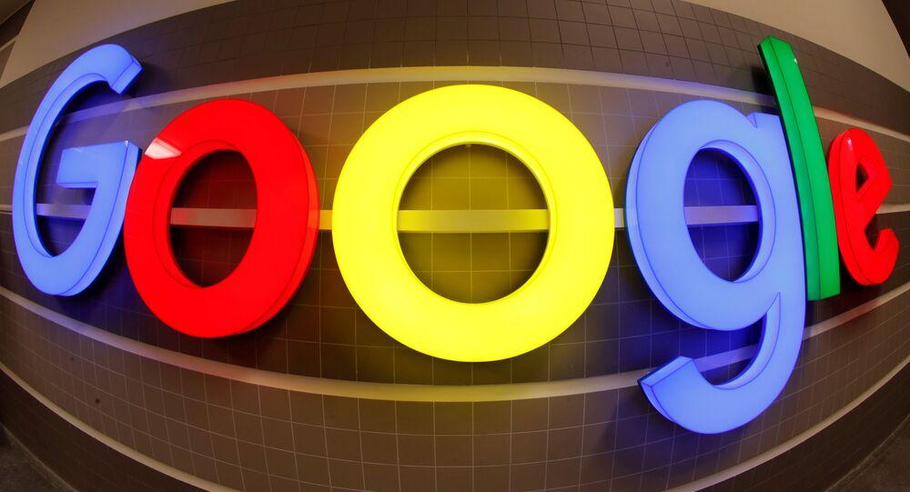 An illuminated Google logo inside an office building in Zurich, Switzerland, December 5, 2018