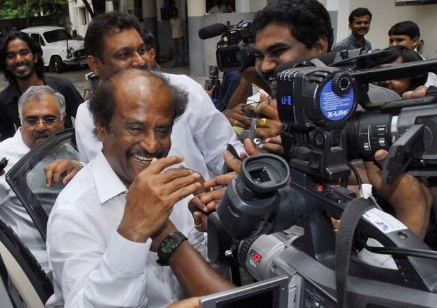 One of India's highest-paid actors, Rajnikanth, arrives for the preview of his latest film, 'Sivaji' in Hyderabad, India, Thursday, June 14, 2007