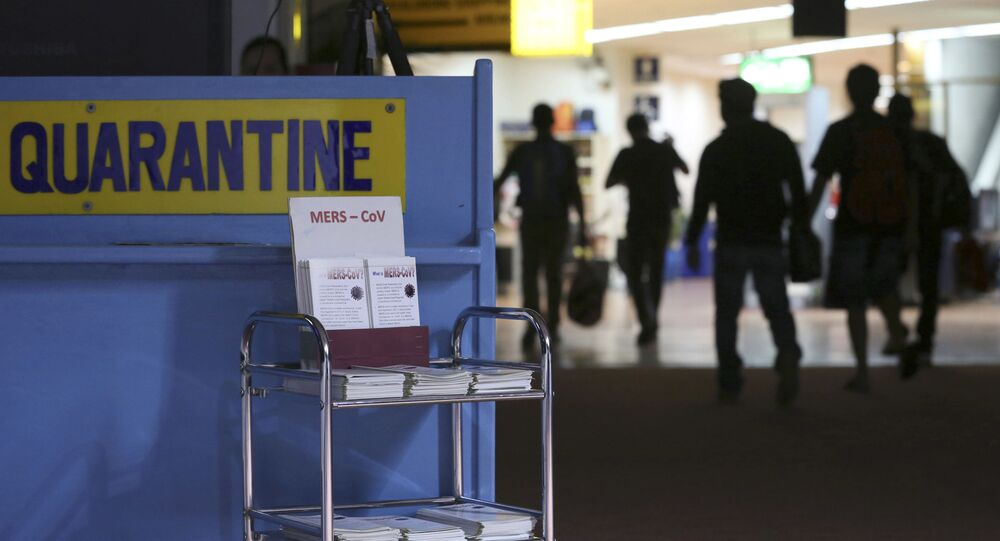 Passengers walk past the medical quarantine area showing information sheets for the Middle East respiratory syndrome coronavirus (File)