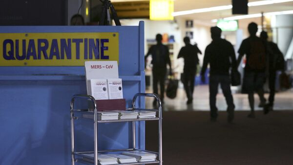 Passengers walk past the medical quarantine area showing information sheets for the Middle East respiratory syndrome coronavirus (File) - Sputnik International
