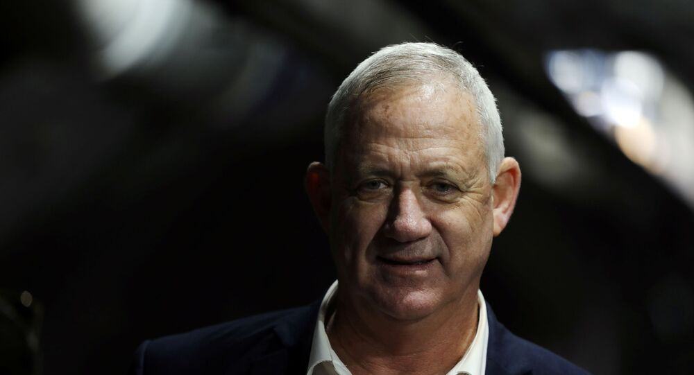 Benny Gantz, leader of Blue and White party, smiles as he walks inside a tunnel while touring The City of David, a Jewish heritage site in the Palestinian neighbourhood of Silwan, East Jerusalem January 14, 2020.