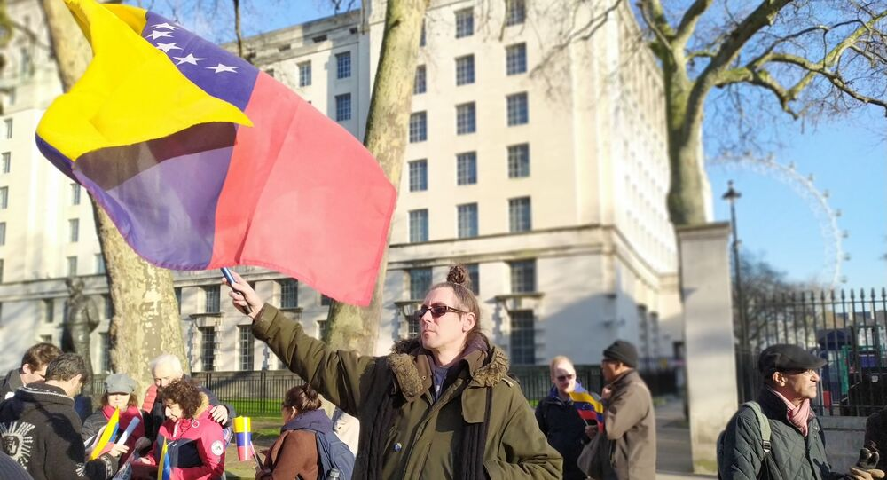 Man waves Venezuelan flag across from number 10 Downing Street during demo on 21 January 2020
