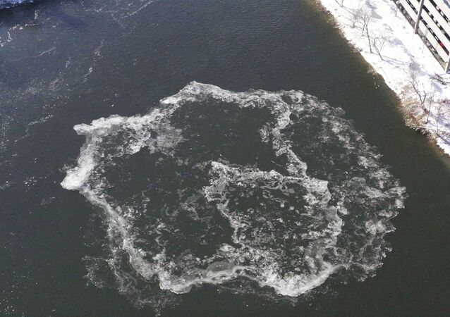 This photo provided by the city of Westbrook, Maine shows Westbrook shows an ice disk forming in the Presumpscot River in Westbrook, Maine on Jan. 17, 2020.  The formation comes just about a year after a disk measuring about 100 yards was spotted in the same river. It eventually had a devoted webcam; social media users compared it to an alien spacecraft and the moon; and ducks used it as a raft. (Tina Radel/City of Westbrook Maine via AP)