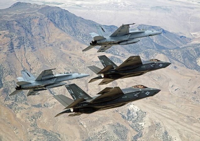 F-35C Lightning IIs and F/A-18E/F Super Hornets