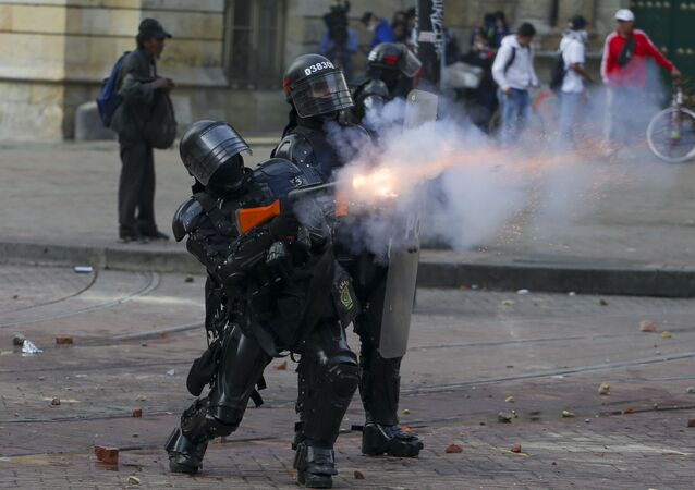 Police during clashes with anti-government protesters in downtown Bogota