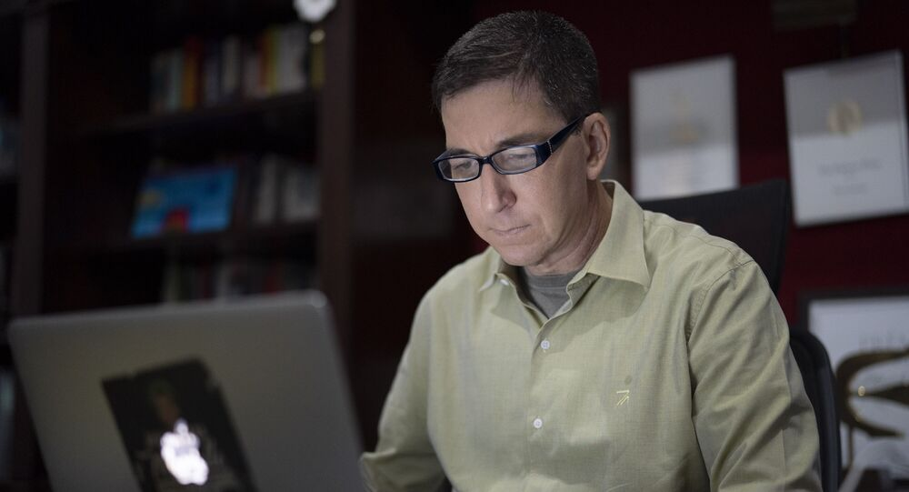 In this July 10, 2019 file photo, U.S. journalist Glenn Greenwald checks his news website at his home in Rio de Janeiro, Brazil. Brazilian prosecutors accused Greenwald on Tuesday, Jan. 21, 2020, of involvement in hacking the phones of Brazilian officials involved in a corruption investigation, though Brazil's high court had blocked investigations of the journalist or his Brazil-based news outlet in relation to the case.
