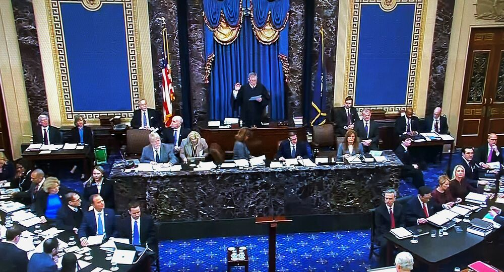 U.S. Supreme Court Chief Justice John Roberts swears in the final senator, Senator James Inhofe (R-OK) as the Chief Justice presides over the start of the U.S. Senate impeachment trial of U.S. President Donald Trump in this frame grab from video shot in the U.S. Senate Chamber at the U.S. Capitol in Washington, U.S., January 21, 2020