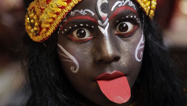 In this Friday, April 13, 2018, file photo, a girl dressed as Hindu goddess Kali waits to join a religious procession during a ritual of Shiva Gajan Hindu festival in Kolkata, India - Sputnik International