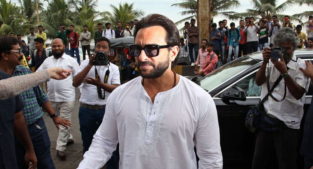 Bollywood actor Saif Ali Khan arrives for a promotional event for his film 'Happy Ending' in Mumbai, India, Saturday, Nov. 15, 2014