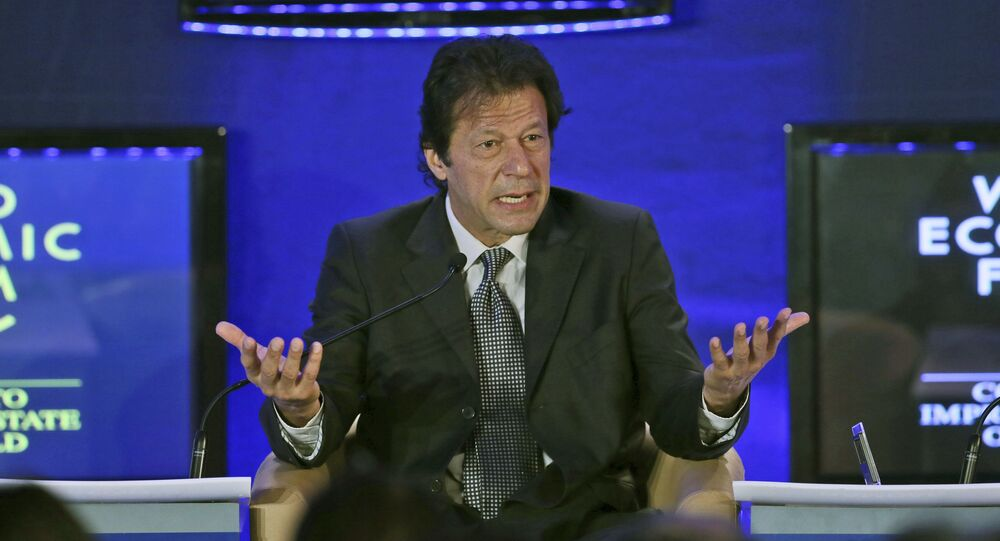 FILE - In this Nov. 7, 2012 file photo  Pakistan Tehreek-e-Insaf Chairman, and former cricket captain Imran Khan  speaks at the World Economic Forum in Gurgaon, on the outskirts of New Delhi, India