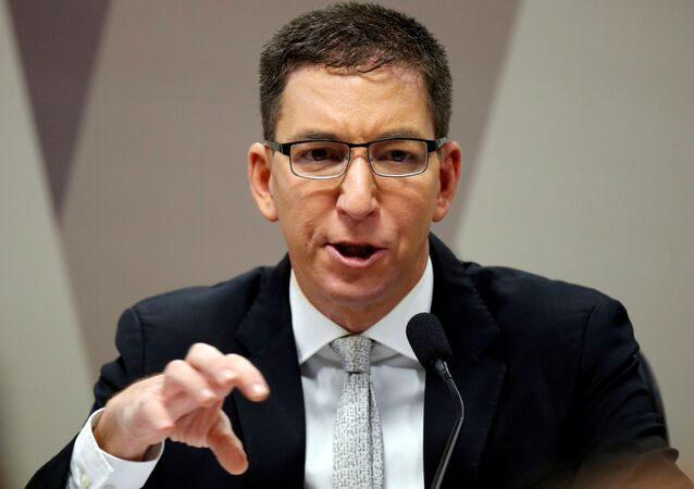 Author and journalist Glenn Greenwald speaks during a meeting at Commission of Constitution and Justice in the Brazilian Federal Senate in Brasilia