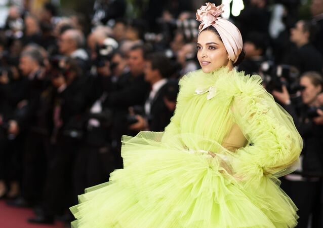 Actress Deepika Padukone poses for photographers upon arrival at the premiere for the film 'Pain and Glory' at the 72nd international film festival, Cannes, southern France, Friday, May 17, 2019.