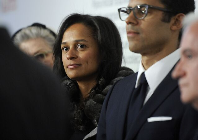 Isabel dos Santos, Africa's richest woman, stands next to her husband and art collector Sindika Dokolo