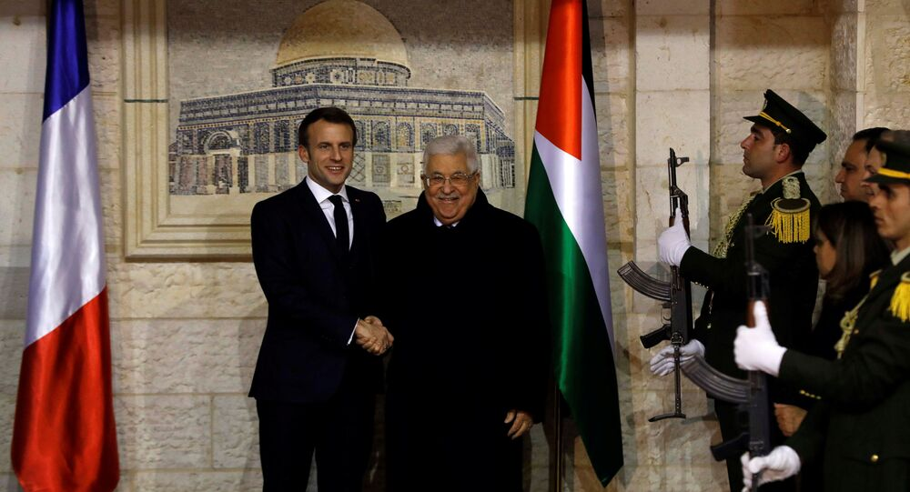French President Emmanuel Macron shakes hands with Palestinian President Mahmoud Abbas in Ramallah in the Israeli-occupied West Bank January 22, 2020