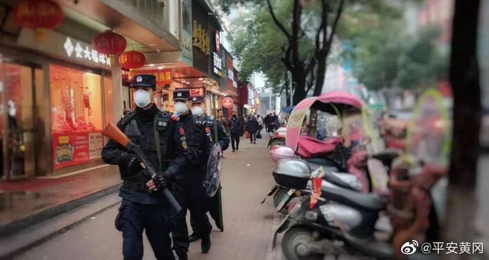 Police officers wear face masks amid the coronavirus outbreak in China