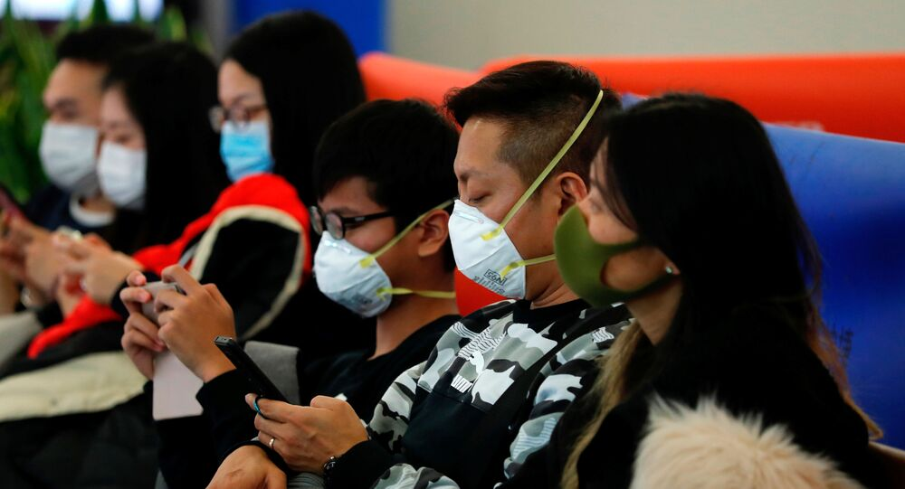 Passengers wear masks to prevent an outbreak of a new coronavirus at the Hong Kong West Kowloon High Speed Train Station, in Hong Kong, China January 23, 2020.
