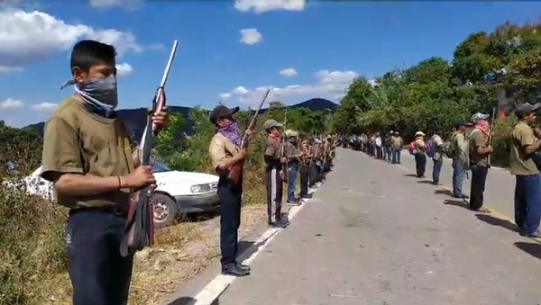 Armed boys as young as 12 stand at attention after receiving training from a community policing group in southern Mexico. - Sputnik International
