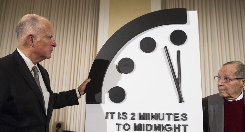 Former California Gov. Jerry Brown, left, and former Secretary of Defense William Perry unveil the Doomsday Clock during The Bulletin of the Atomic Scientists news conference in Washington, Thursday, Jan. 24, 2019.