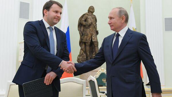 Russian President Vladimir and Economy Minister Maksim Oreshkin - Sputnik International