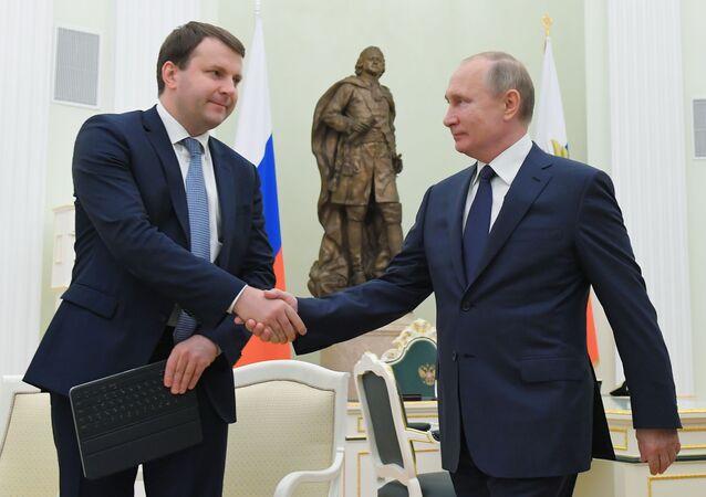 Russian President Vladimir and Economy Minister Maksim Oreshkin